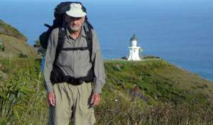 Te Araroa trail blog - Bob at Cape Reinga with lighthouse in background